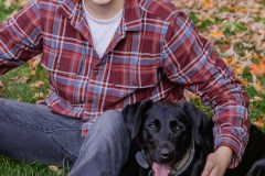 Yearbook photos at home in the fall. A boy with his dog. Class o
