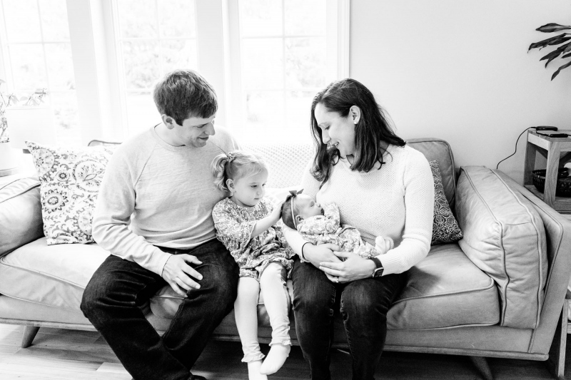 Family of three becomes a family of four with the addition of ba
